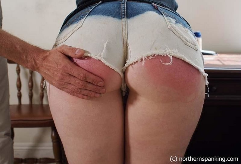 acid-washed jeans shorts do not protect her bottom from spanking