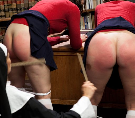 spanking nun punishes two girls at the same time with a pair of rulers