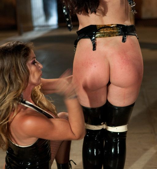 a hard hand spanking for a tied fetish girl