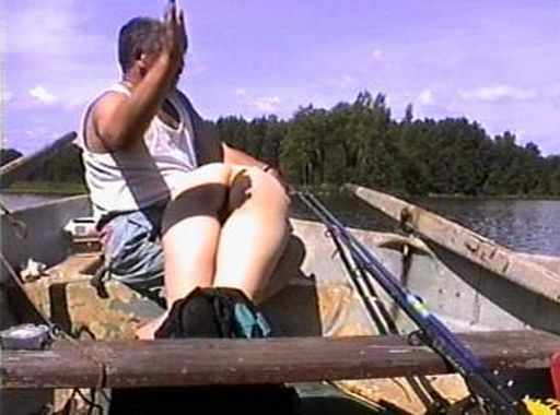spanked naked while on a boat in the middle of a lake in broad daylight