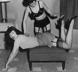 betty page enjoys a spanking