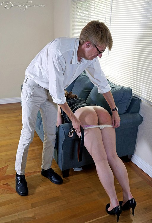 taking down her panties for a belt spanking