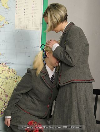 spanked and blubbering schoolgirl is comforted by another