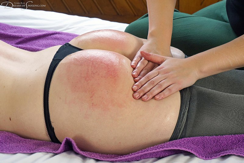 massaging a spanked bottom