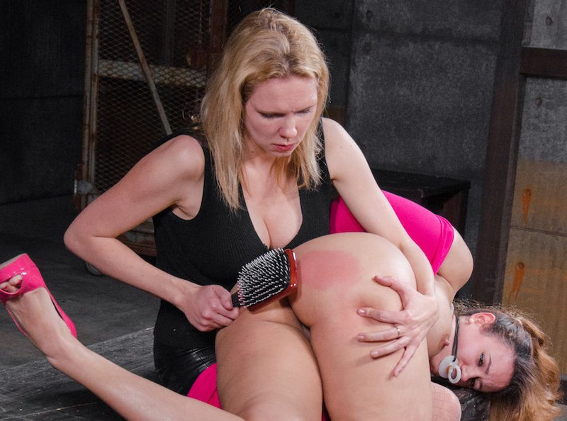 spanking Penny Barber's bottom with a hairbrush