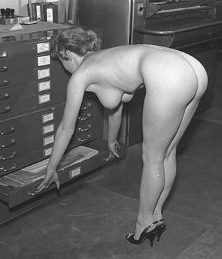 naked office worker begging for a swat while filing maps and plats