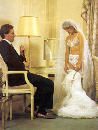 bride reluctantly strips for her bridal night spanking