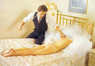 bride strips naked but for her veil and accepts a wedding night caning