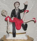 plastic groom spanks plastic bride