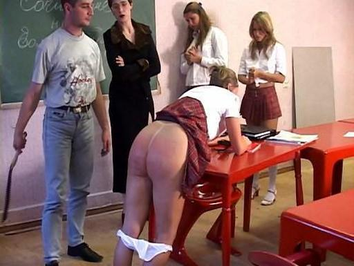 schoolgirl about to get the leather strap