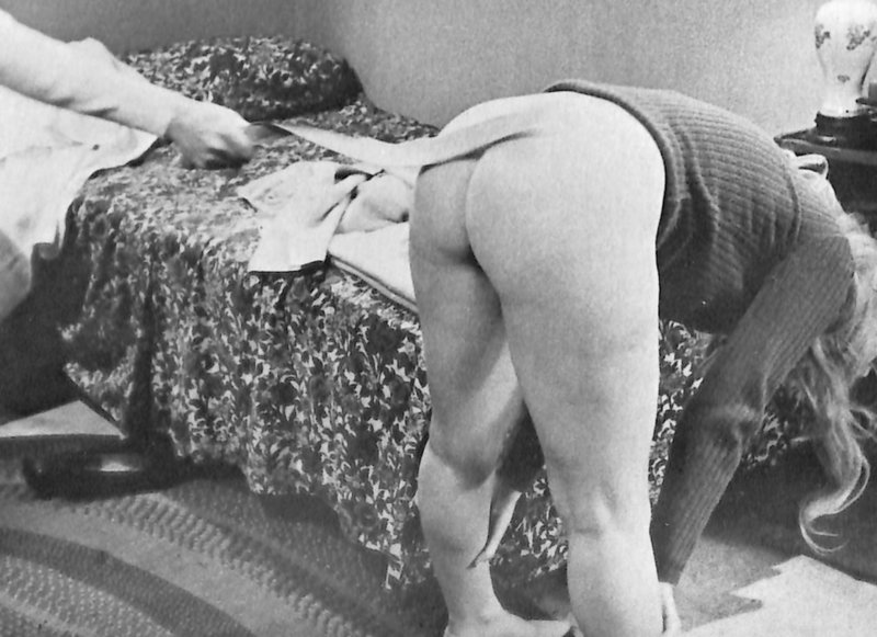 belt spanking from a lesbian in a 1960s nudie sexploitation movie