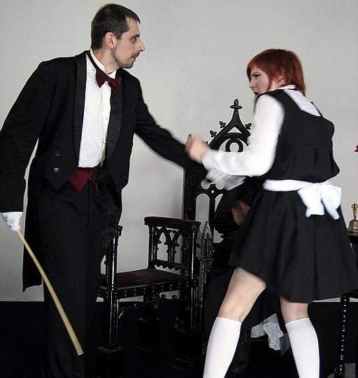 feisty ginger girl struggles to avoid her caning punishment