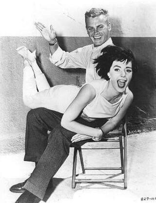 Tab Hunter spanks Natalie Wood over his knee in The Girl He Left Behind