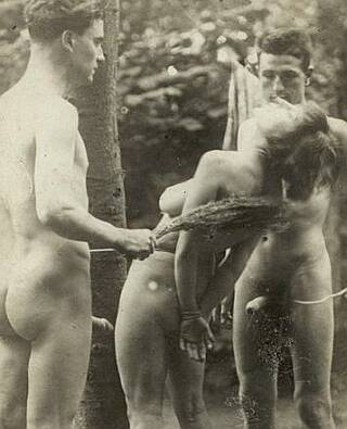nude woman tied and birched by two eager guys