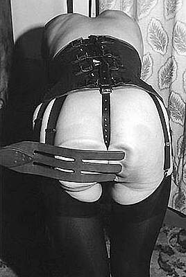 triple-tongued leather tawse spanking