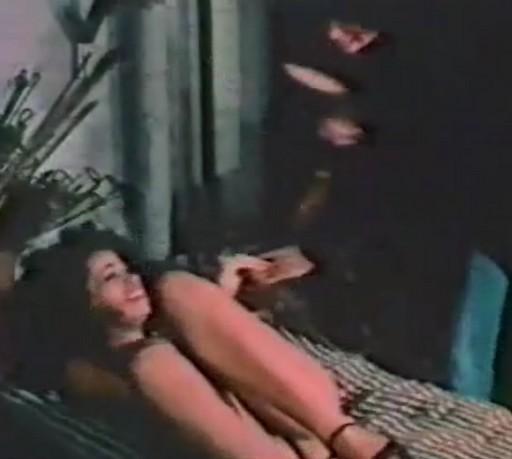 Vanessa del Rio struggles to avoid a lesbian spanking on a dirty mattress