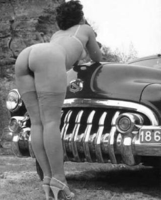 bent over bumper of classic auto for spanking