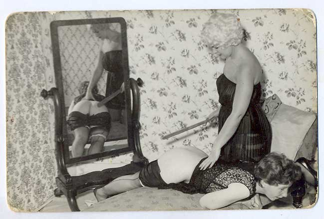 vintage spanking postcard with well-placed mirror