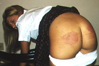 spanked over a chair and looking sore
