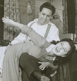 Al Siegel spanking an unknown woman, probably a singer
