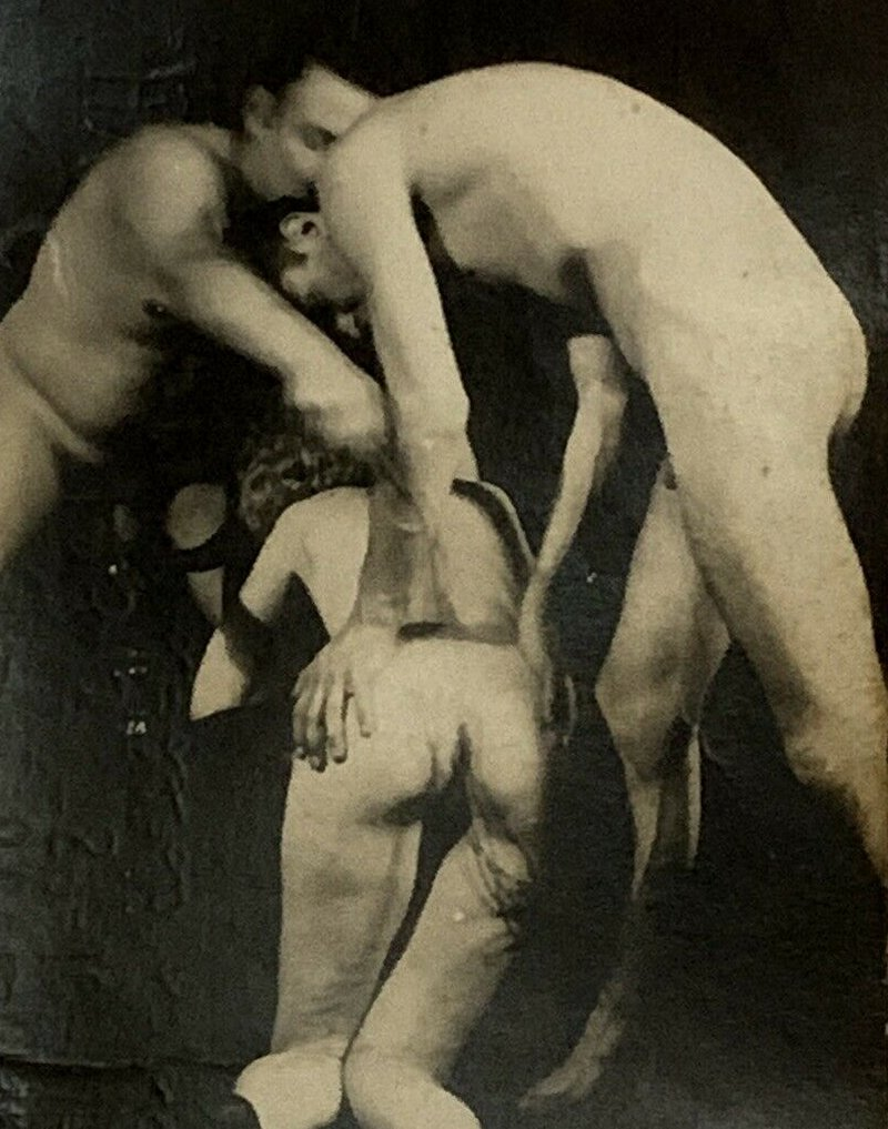 woman whipped by two men in vintage whipping photo