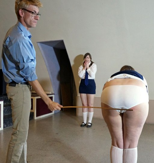 truant schoolgirl caned while her accomplice looks on in fear