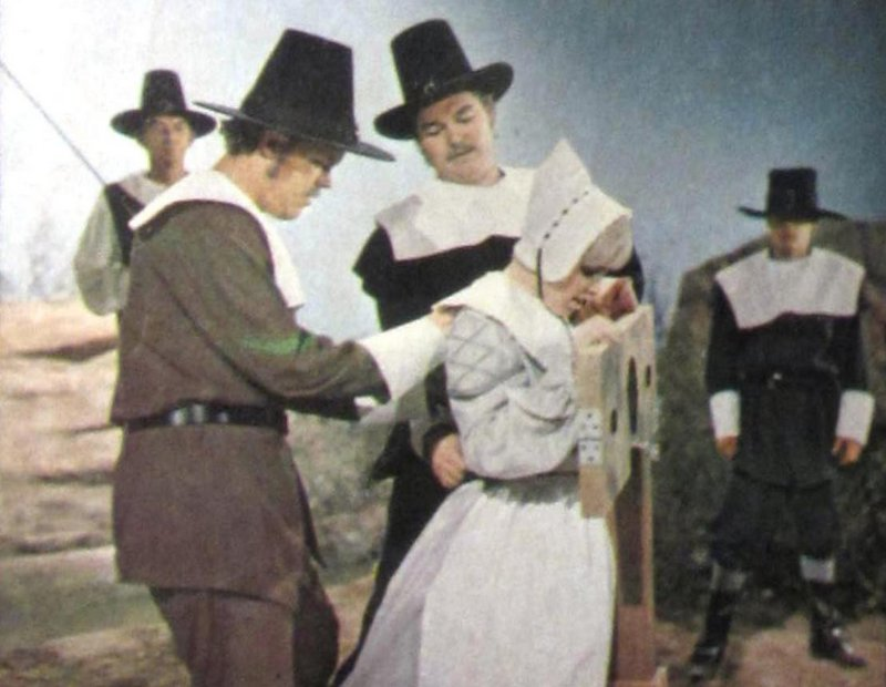 four puritans strip an adulteress for exposure in the stocks and a public whipping