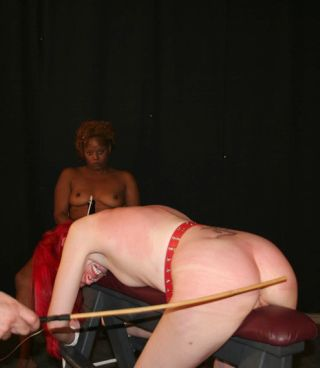 whipped girl on leather spanking bench
