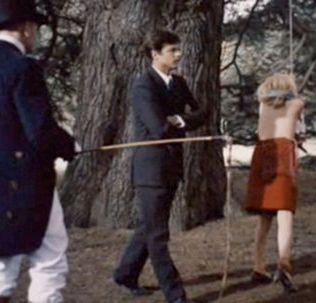 an outdoor whipping in Belle de Jour