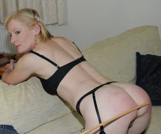 caning his blonde wife
